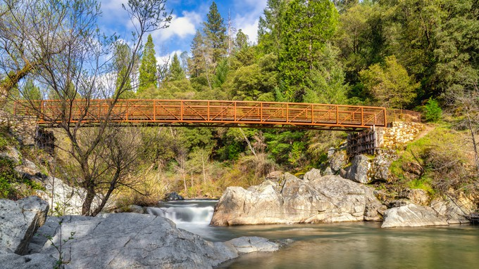 A picture of a footbridge over a river in Nevada City.