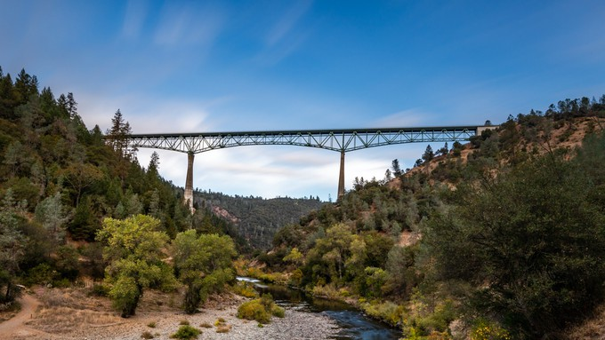 A picture of a bridge over a river in Auburn.