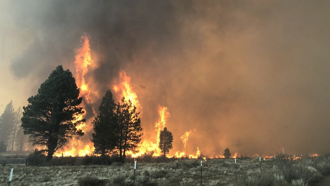 Image caption: A raging Oregon wildfire is bearing down on one of California's main power transmission routes.