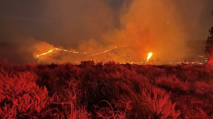 Image caption: PG&E reports that a power line may have caused the 60,000-acre Dixie Fire.